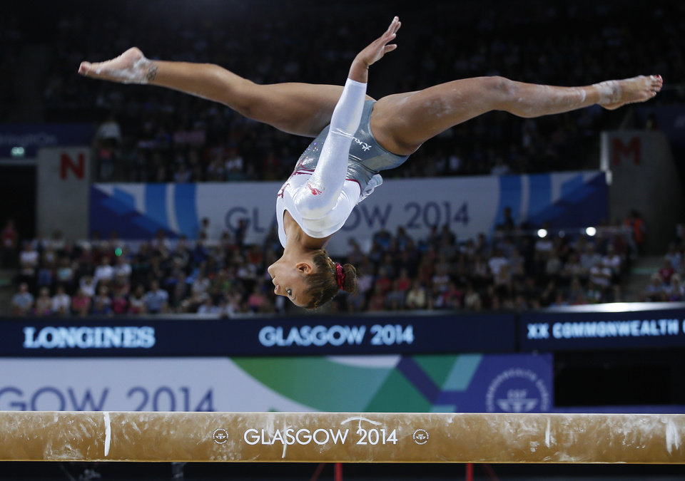 Photo - AP10ThingsToSee - Claudia Fragapane, of England, leaps during her beam routine as she takes part in the women's team final and individual qualification gymnastic competition at the Commonwealth Games Glasgow 2014, in Glasgow, Scotland, Tuesday, July, 29, 2014. (AP Photo/Alastair Grant)