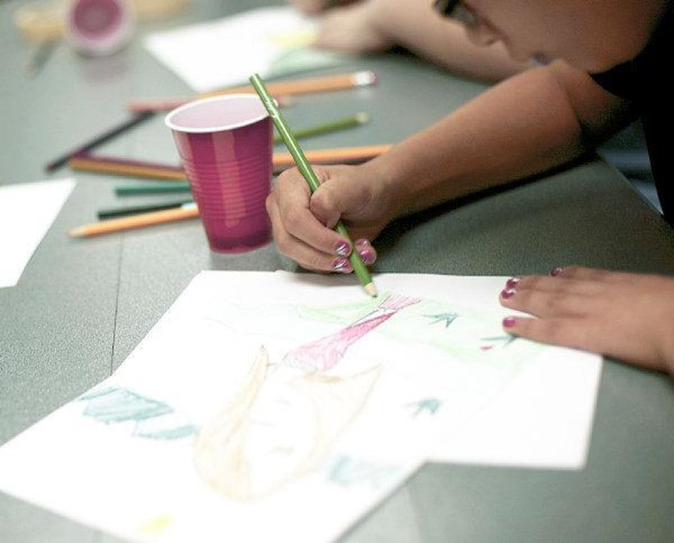 Harmonee Wilfong, age 11, works on the first part of her digital mixed media project during an after school art class at Capitol Hill Library in south Oklahoma City on Monday, September 12, 2011. Photo by John Clanton, The Oklahoman ORG XMIT: KOD