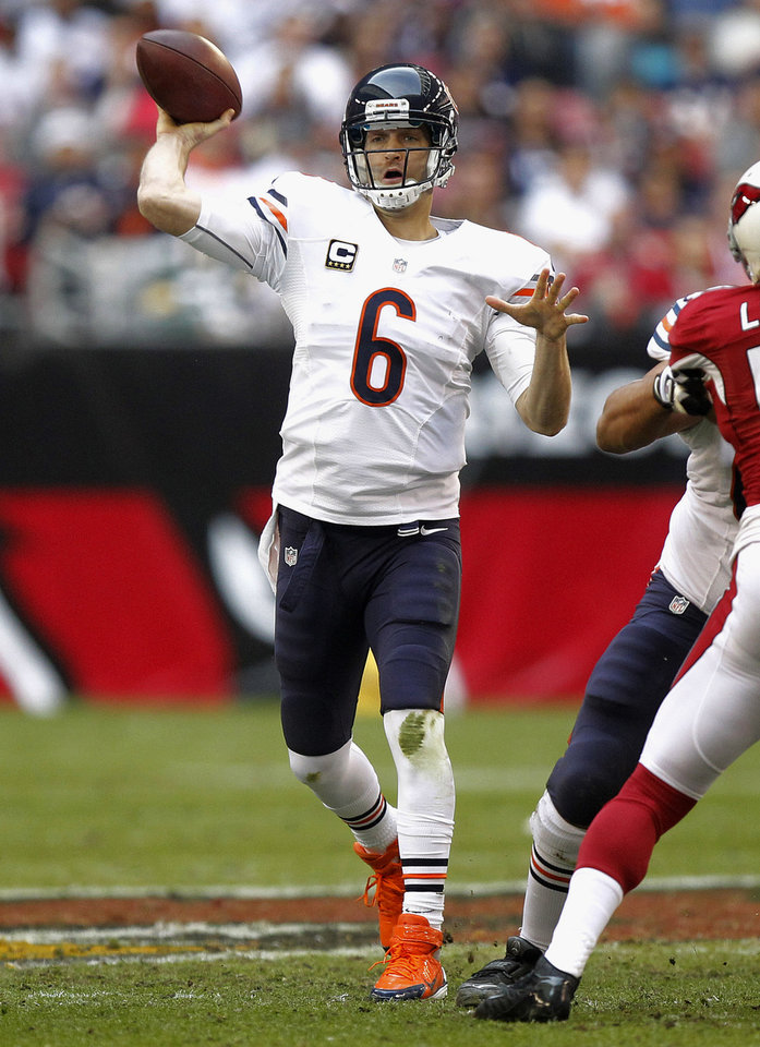 Photo - Chicago Bears quarterback Jay Cutler (6) throws against the Arizona Cardinals during the first half of an NFL football game, Sunday, Dec. 23, 2012, in Glendale, Ariz. (AP Photo/Paul Connors)