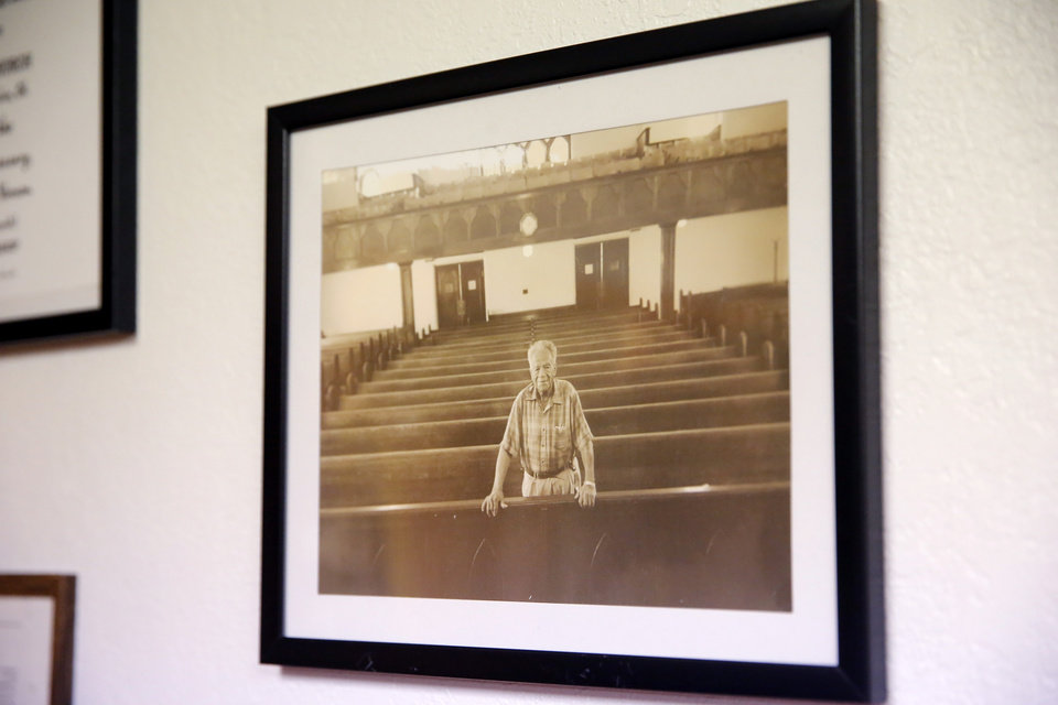 Photo - A picture of Robert Fairchild, Sr., is pictured at the Vernon A.M.E Church in the Greenwood district in Tulsa, Okla., Wednesday, July 22, 2020. Fairchild was a survivor of the 1921 Tulsa Race Massacre. Photo by Sarah Phipps, The Oklahoman