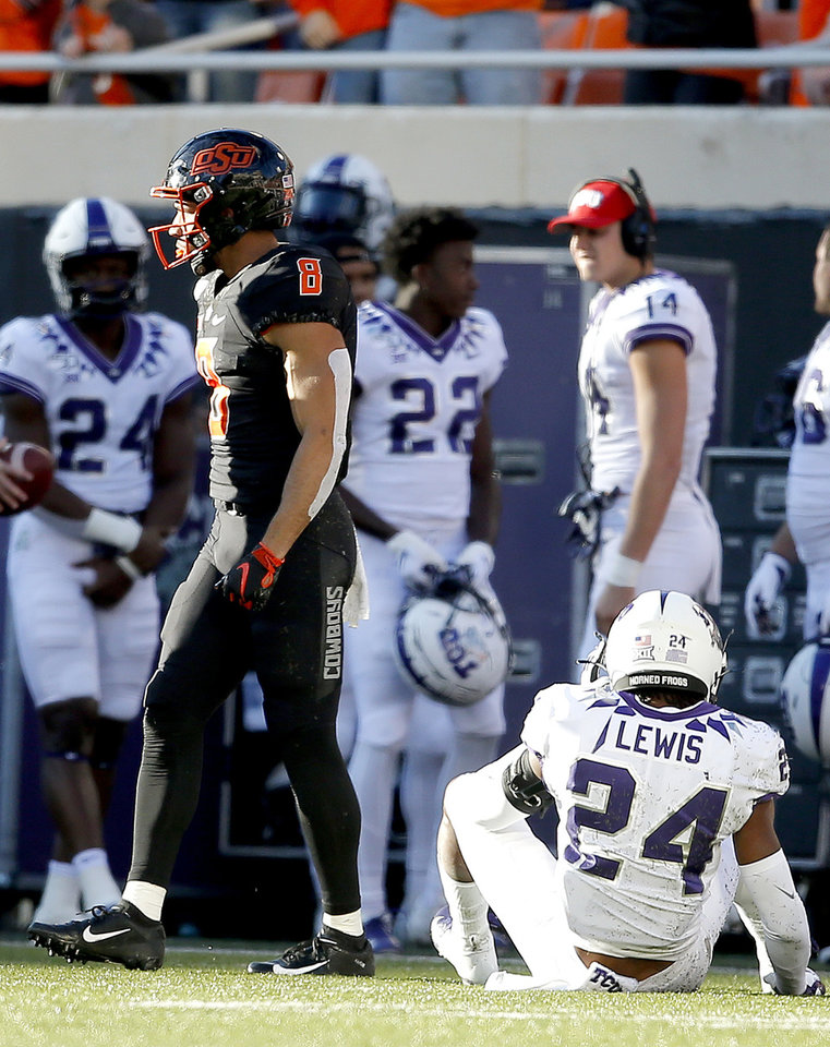 Photo - Oklahoma State's Braydon Johnson (8) reacts after his reception over TCU's Julius Lewis (24) in the fourth quarter  during the college football game between the Oklahoma State University Cowboys and the TCU Horned Frogs at Boone Pickens Stadium in Stillwater, Okla.,  Saturday, Nov. 2, 2019. OSU won 34-27. [Sarah Phipps/The Oklahoman]