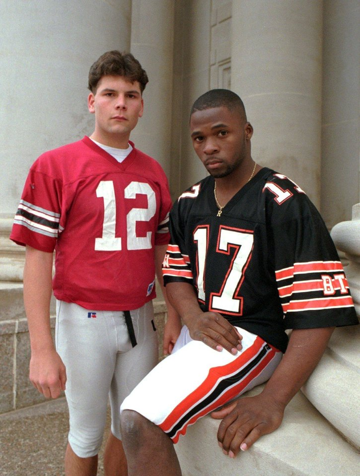 Photo - The Oklahoman 1994 High School Football All state team members R.W. McQuarters (defensive player of the year) and Justin Fuente (offensive player of the year).