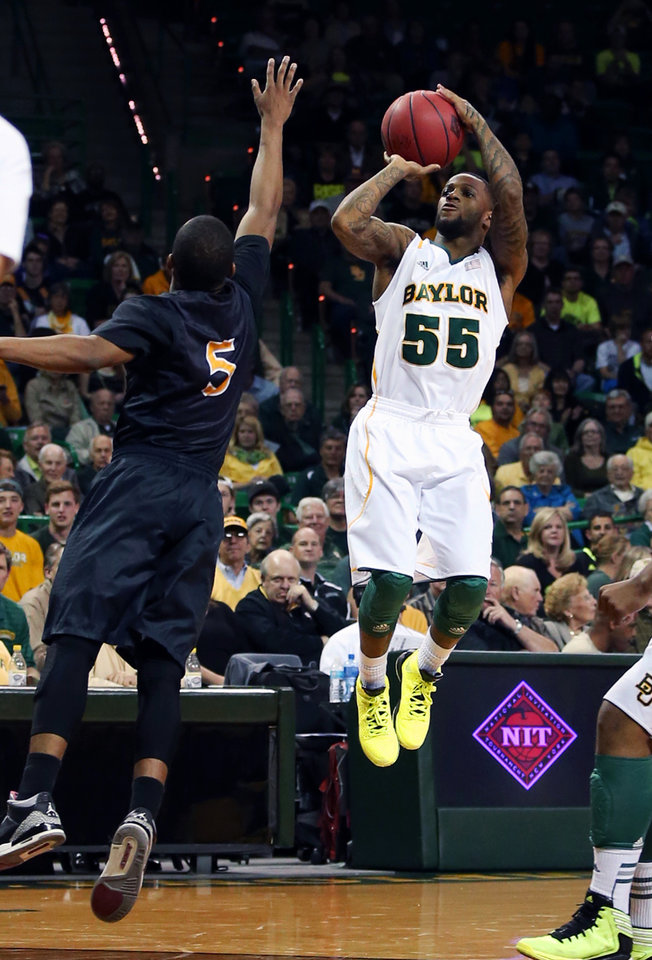 Photo - Baylor's Pierre Jackson (55) shoots over Long Beach State's Mike Caffey (5) during the first half of an NIT first-round college basketball game in Waco, Texas, Wednesday, March 20, 2013. (AP Photo/Waco Tribune Herald, Jerry Larson)