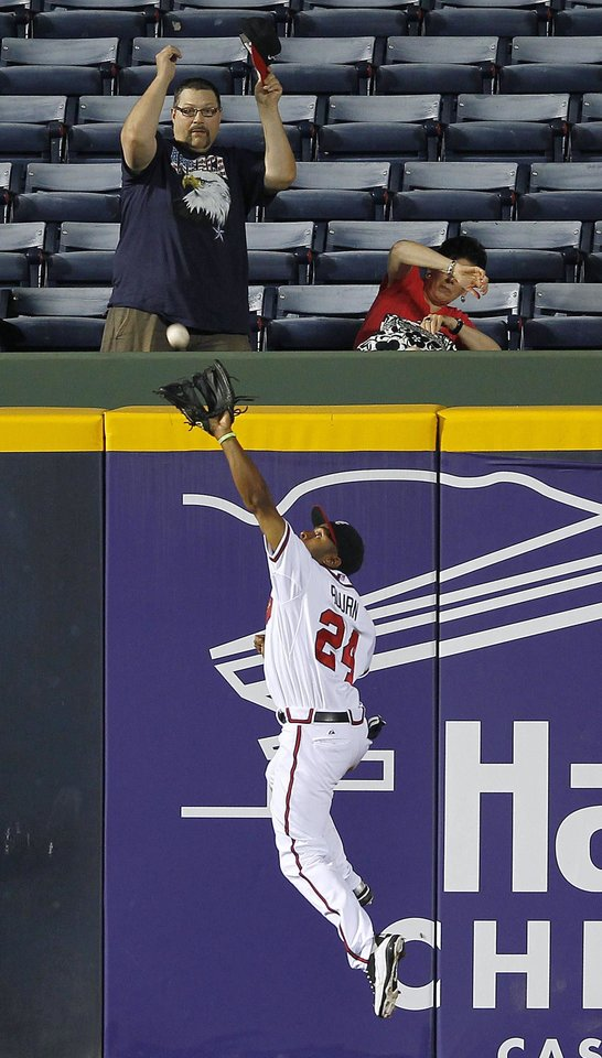 Photo -   Atlanta Braves center fielder Michael Bourn makes a catch at the wall for the out on Colorado Rockies' Josh Rutledge in the ninth inning of a baseball game Tuesday, Sept. 4, 2012, in Atlanta. (AP Photo/John Bazemore)