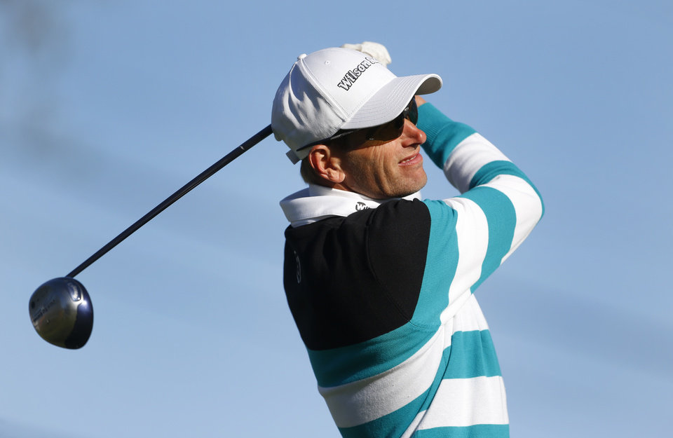 Photo - Steen Tinning, of Denmark, watches his tee shot on the 18th hole during the second round of the Senior PGA Championship golf tournament at Harbor Shores Golf Club in Benton Harbor, Mich., Friday, May 23, 2014. (AP Photo/Paul Sancya)