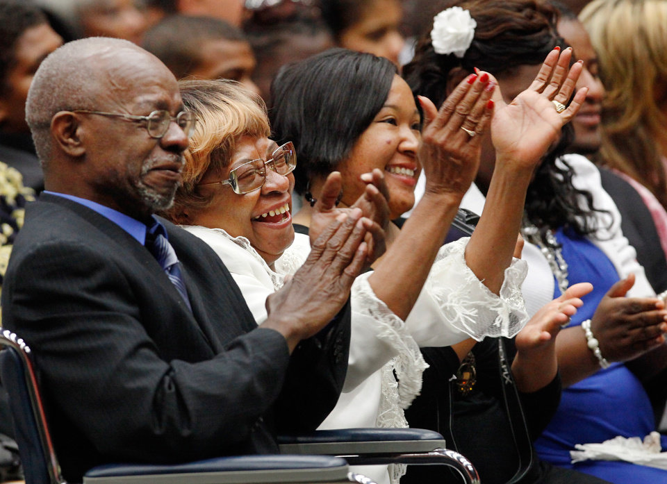 Photo - Family members laugh and applaud a speaker.  At left is son Calvin Luper. Next to her is daughter Marilyn Hildreth. . About 2,500 people celebrated the life and legacy of Oklahoma City civil rights pioneer Clara Mae Shepard Luper  during a lively service in the Cox Convention Center that lasted more than three hours, Friday,  June 17, 2011.  Luper died  last week at the age of 88. Photo by Jim Beckel, The Oklahoman