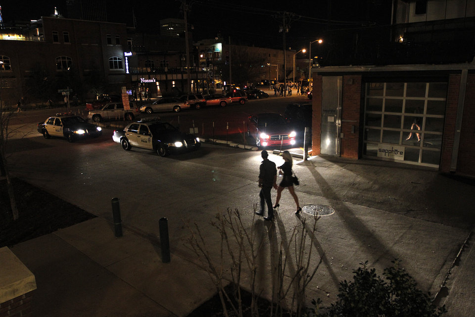 Photo - Crowds of people leave bars in the Bricktown area in Oklahoma City, Saturday, March 24, 2012.  There have been several assaults near bars in Bricktown the last eight months.  Photo by Garett Fisbeck, For The Oklahoman