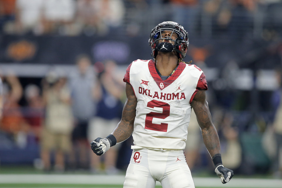 Photo -  Oklahoma's CeeDee Lamb celebrates after scoring a touchdown during Saturday's Big 12 title game in Arlington, Texas. [PHOTO BY BRYAN TERRY, The Oklahoman]