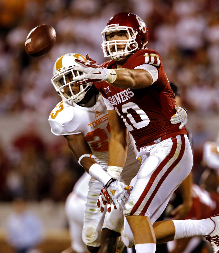 Photo - Tennessee's Cameron Sutton (23) covers Oklahoma's Blake Bell (10) on a pass play during the second half of a college football game between the University of Oklahoma Sooners (OU) and the Tennessee Volunteers at Gaylord Family-Oklahoma Memorial Stadium in Norman, Okla., on Saturday, Sept. 13, 2014. Photo by Steve Sisney, The Oklahoman
