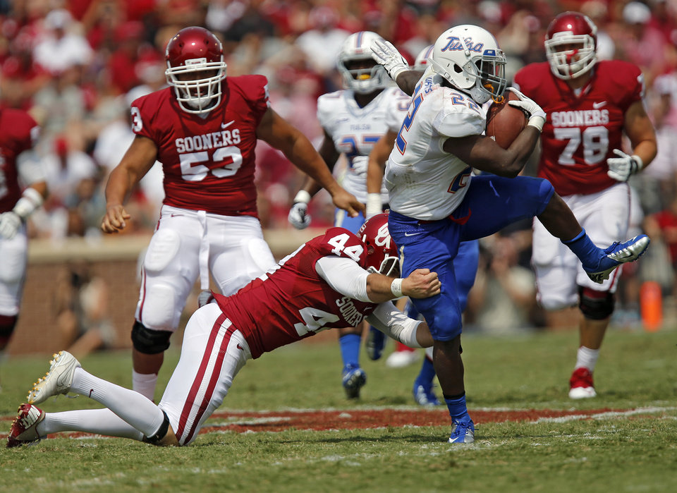 Tulsa 's Trey Watts (22) runs a kick return past Oklahoma's Jed Barnett (44) during the college football game between the University of Oklahoma Sooners (OU) and the University of Tulsa Hurricanes (TU) at the Gaylord-Family Oklahoma Memorial Stadium on Saturday, Sept. 14, 2013 in Norman, Okla.  Photo by Chris Landsberger, The Oklahoman