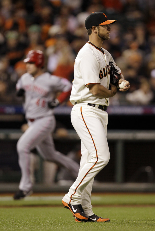 Photo -   Cincinnati Reds' Ryan Ludwick rounds the bases after he hit a solo home run off of San Francisco Giants pitcher Madison Bumgarner, right, in the second inning during Game 2 of the National League division baseball series in San Francisco, Sunday, Oct. 7, 2012. (AP Photo/Eric Risberg)
