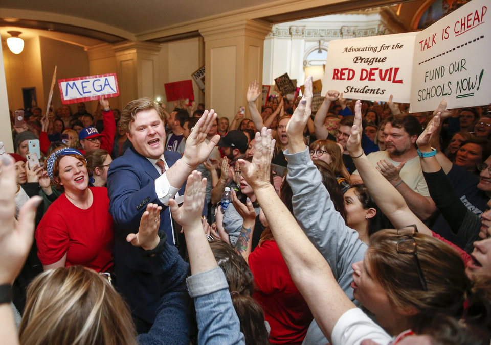 Photo - Rep. Forrest Bennett, D-Oklahoma City, greets teachers, students and supporters of increased education funding as he makes his way to the entrance to the House of Representatives chamber on the fourth floor during the third day of a walkout by Oklahoma teachers at the state Capitol in Oklahoma City, Wednesday, April 4, 2018. Photo by Nate Billings, The Oklahoman