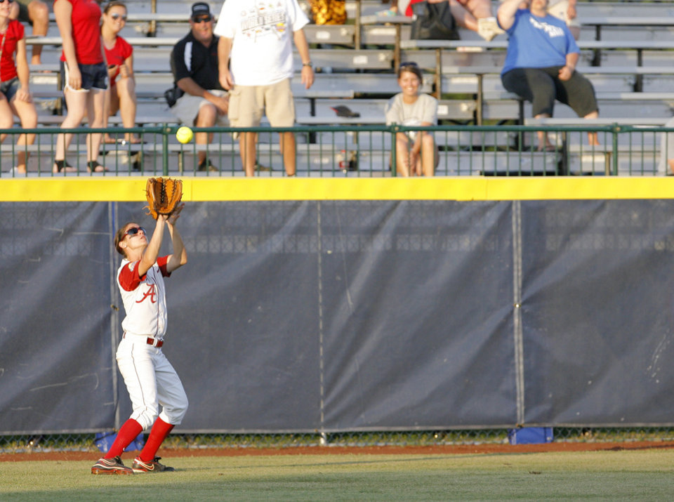 Photo - Alabama's Jennifer Fenton (7) catches a ball during the Women's College World Series game between Alabama and Florida at the ASA Hall of Fame Stadium in Oklahoma City, Sunday, June 5, 2011. Photo by Garett Fisbeck, The Oklahoman