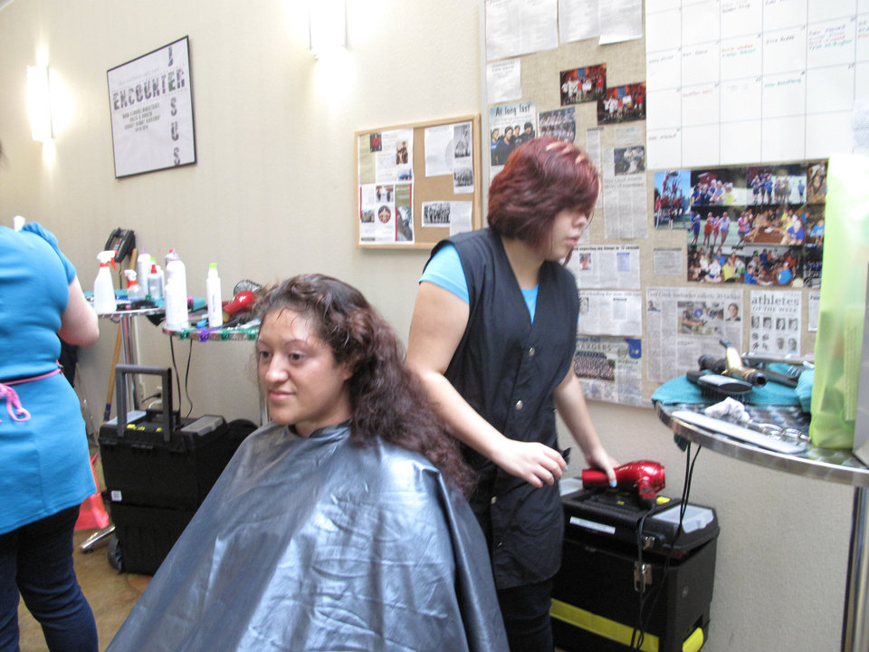 "Alejandra Ordonez gets her hair washed and styled by Ingrid Valas, a Francis Tuttle cosmotology student during the Single Parent Support Network's recent ""Queen For A Day"" event at United Methodist Church of the Servant, 14343 N Portland. Photo by Carla Hinton, The Oklahoman <strong></strong>"