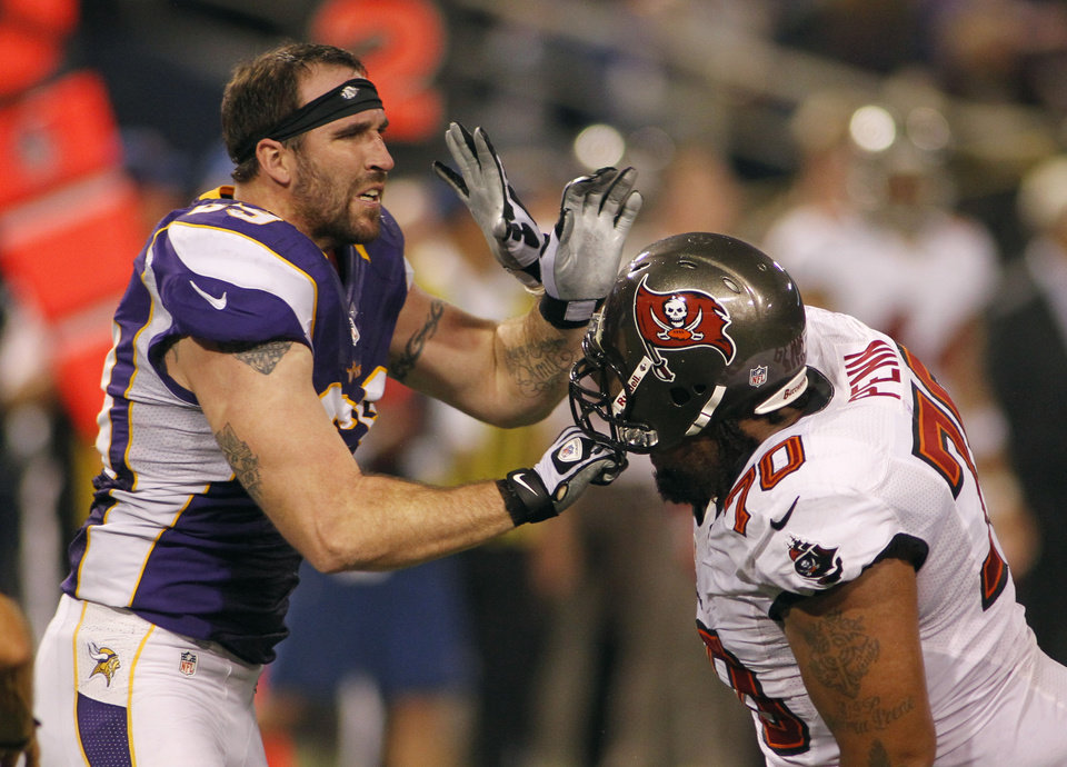 Photo -   Minnesota Vikings defensive end Jared Allen, left, gets in a tussle with Tampa Bay Buccaneers tackle Donald Penn, right, during the second half of an NFL football game Thursday, Oct. 25, 2012, in Minneapolis. (AP Photo/Andy King)