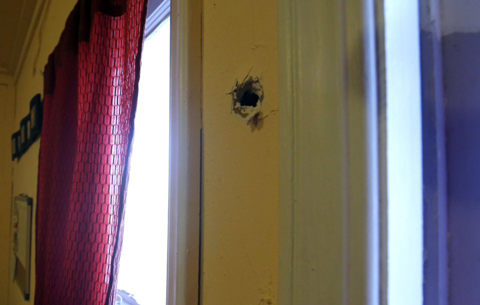 A bullet hole is shown Friday at the Taghavi home in Oklahoma City. Photo by Sarah Phipps, The Oklahoman
