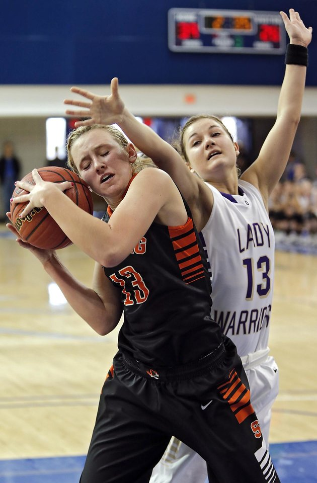 Okarche\'s Rae Grellner (13) defends on Sterling\'s Laurie Derrico (13) during the Class A girls state quarterfinal game between Okarche and Sterling at Oklahoma City University on Thursday, Feb. 28, 2013, in Oklahoma City, Okla. Photo by Chris Landsberger, The Oklahoman