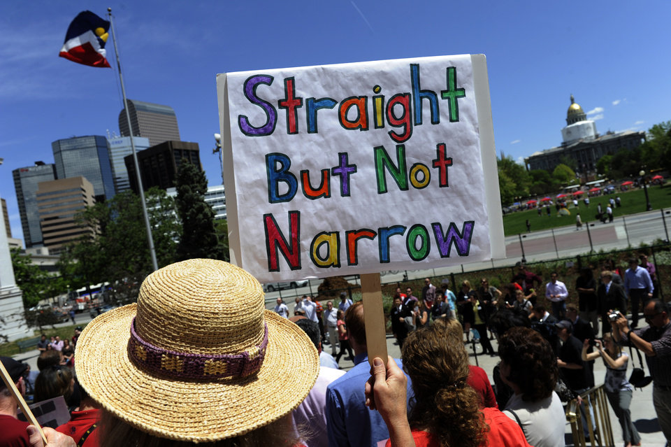Photo -   Ann Ogg, of Littleton, carries a sign during a rally supporting civil unions at the Denver City and County Building in Denver, Thursday, May 3, 2012. Ogg said she was there to support her lesbian daughter. She said,