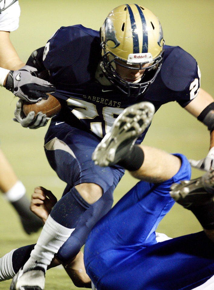 Photo - Southmoore's Andrew Long (26) carries against Sapulpa in high school football at Moore High School field on Thursday, Sept. 30, 2010, in Norman, Okla.  Photo by Steve Sisney, The Oklahoman