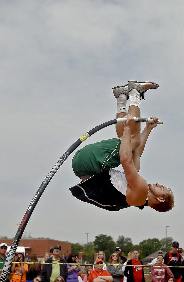 Photo - Catoosa's Darren Fowler competes in the Class 5A boys pole vault during the Class 6A and 5A state championship track meet at Yukon High School on Saturday, May 17, 2014 in Yukon, Okla.   Photo by Chris Landsberger, The Oklahoman