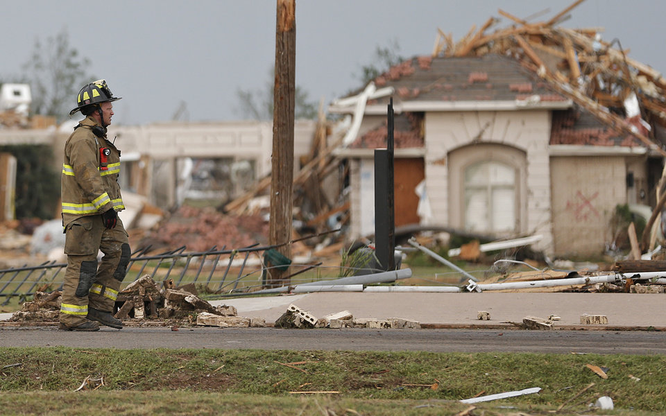 Emergency crews survey the area  destroyed by a tornado near 149th and Drexel on Monday, May 20, 2013 in Oklahoma City, Okla.  Photo by Chris Landsberger, The Oklahoman