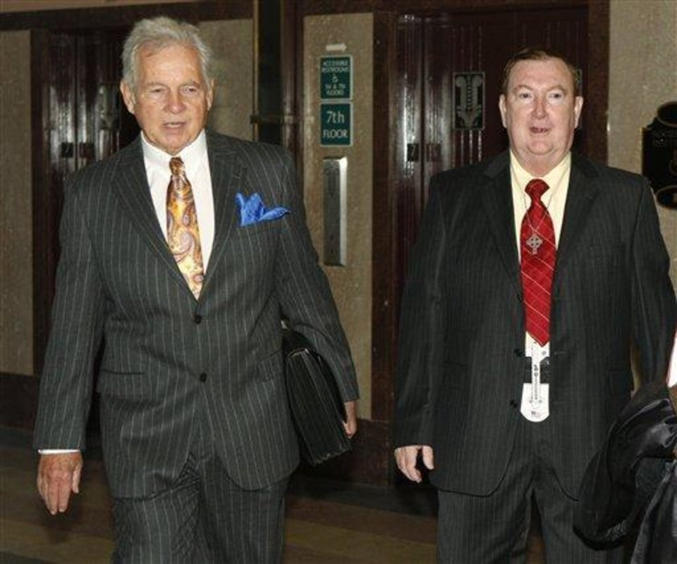 Attorney Irven Box, left, arrives at court with his client, Jerome Ersland , right, in Oklahoma City today. AP Photo