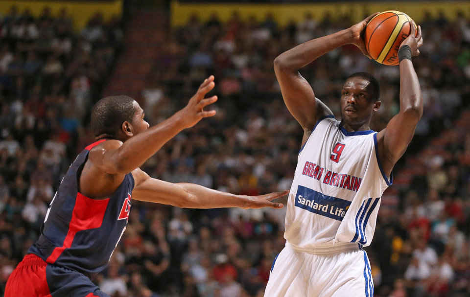 Photo -   Great Britain's Luol Deng, right, looks for a pass under pressure from USA's Kevin Durant during an Olympic Warm Up match against the USA at the Manchester Arena, Manchester Thursday July 19, 2012. (AP Photo/ Dave Thompson/PA Wire) UNITED KINGDOM OUT