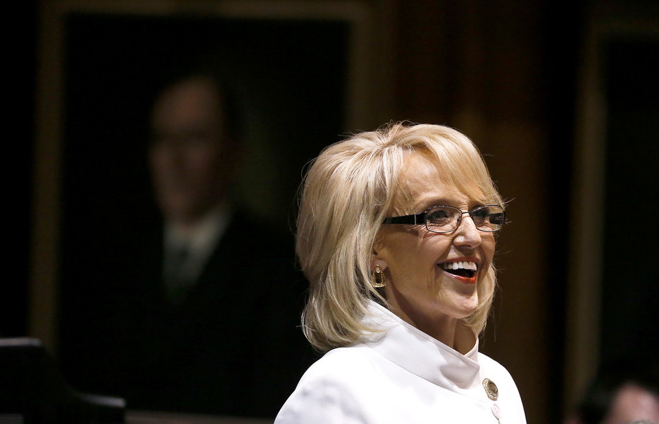 Arizona Gov. Jan Brewer smiles as she gives her State of the State address at the Arizona Capitol, Monday, Jan. 14, 2013, in Phoenix. (AP Photo/Ross D. Franklin)