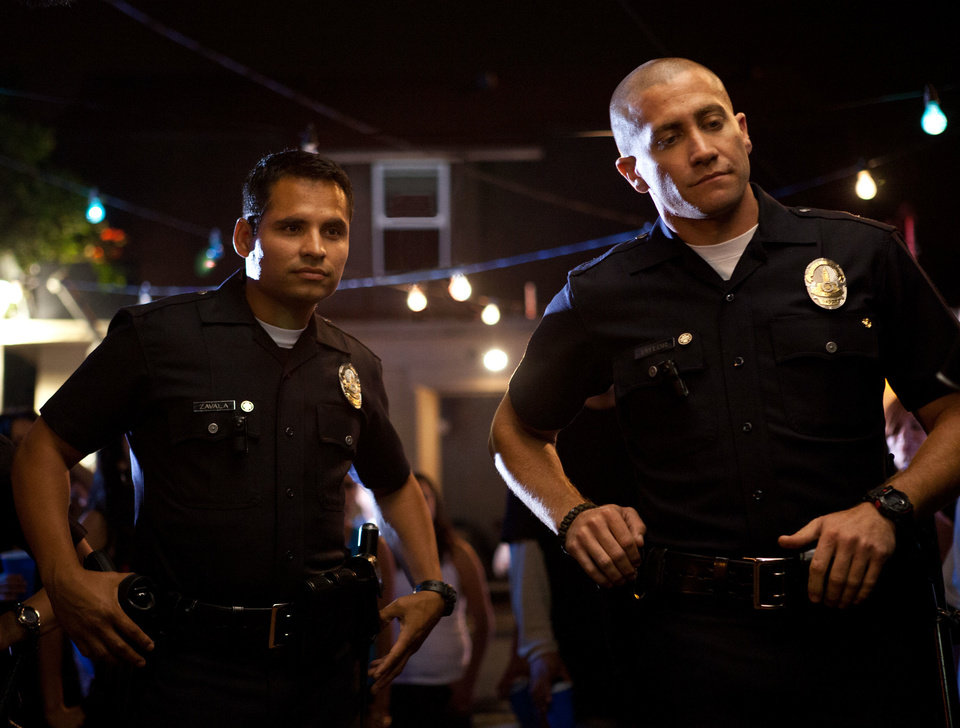 "Michael Pena, left, and Jake Gyllenhaal in a scene from ""End of Watch.""  OPEN ROAD FILMS PHOTO <strong>Scott Garfield</strong>"