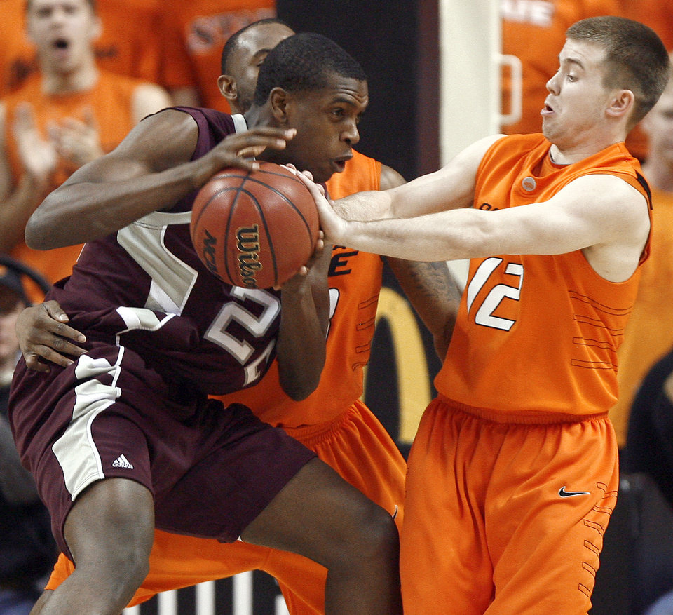 Photo - OSU's Keiton Page defends Texas A&M's Khris Middleton during an NCAA college basketball game between the Oklahoma State University and Texas A&M at Gallagher-Iba Arena in Stillwater, Okla., Wednesday, January 27, 2010. Photo by Bryan Terry, The Oklahoman