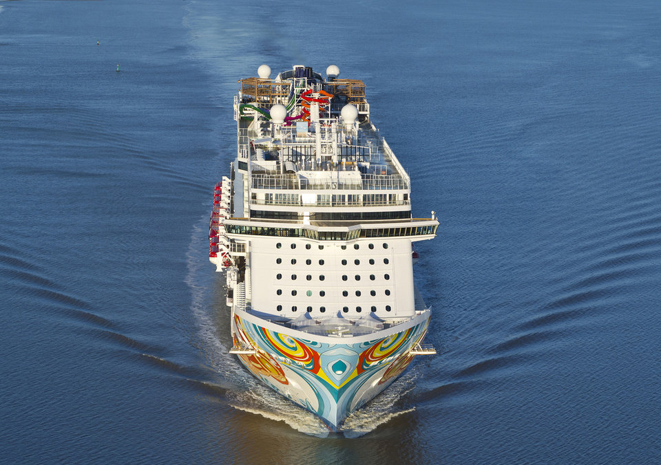 "This undated image provided by Norwegian Cruise Lines shows Norwegian Getaway, a ship debuting this month. It will homeport in Miami and its colorful exterior was designed by Miami-based Cuban-American artist David Le Batard, also known as ""LEBO."" Getaway is a sister ship to Norwegian Breakaway, which debuted in 2013 with a New York theme and homeports from Manhattan. (AP Photo/ Norwegian Cruise Lines)"