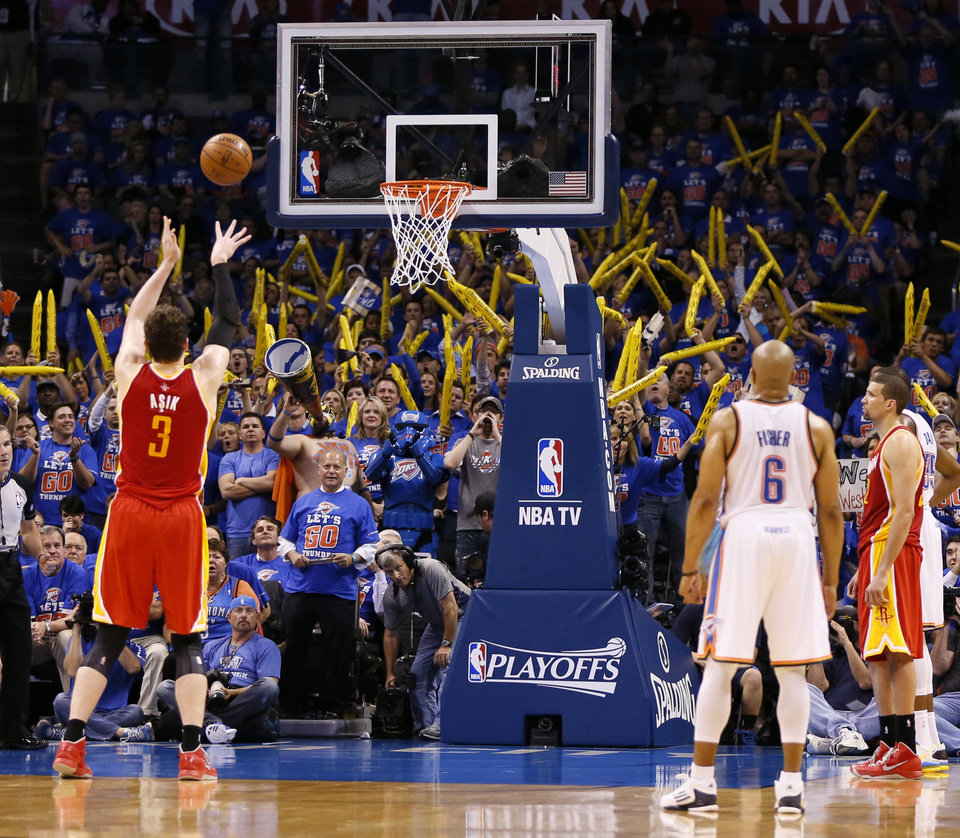 Photo - Houston's Omer Asik (3) takes a foul shot with 5:33 left in the fourth quarter after being intentionally fouled during Game 5 in the first round of the NBA playoffs between the Oklahoma City Thunder and the Houston Rockets at Chesapeake Energy Arena in Oklahoma City, Wednesday, May 1, 2013. Houston won, 107-100. Photo by Nate Billings, The Oklahoman