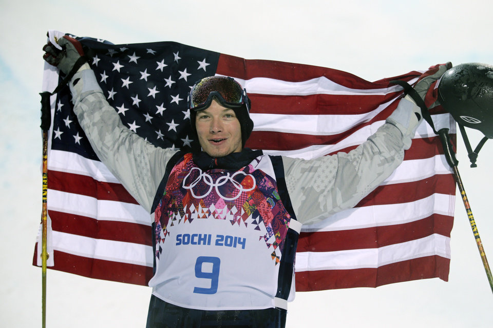 Photo - David Wise, of the United States, celebrates after winning a gold medal in the men's ski halfpipe final at the Rosa Khutor Extreme Park, at the 2014 Winter Olympics, Tuesday, Feb. 18, 2014, in Krasnaya Polyana, Russia. (AP Photo/Jae C. Hong)