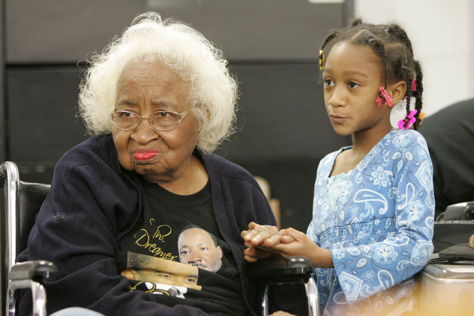 Photo - Civil rights pioneer Clara Luper and 9yr-old Alexia Grant  watch the Inauguration of President Barack Obama. Luper was watching TV at the Freedom Center at NE 26th and Martin Luther King Blvd. in Oklahoma City , Okla. January  20, 2009.  BY STEVE GOOCH, THE  OKLAHOMAN.