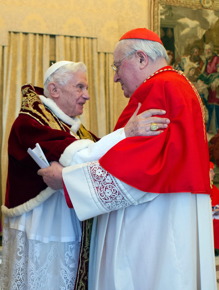 Photo - In this photo provided by the Vatican newspaper L'Osservatore Romano, Pope Benedict XVI, right, and Cardinal Angelo Sodano, Dean of the College of Cardinals, hug each other after the pontiff announced during the meeting of Vatican cardinals that he would resign on Feb. 28, at the Vatican, Monday, Feb. 11, 2013. Benedict XVI announced Monday that he would resign Feb. 28 - the first pontiff to do so in nearly 600 years. The decision sets the stage for a conclave to elect a new pope before the end of March. (AP Photo/L'Osservatore Romano, ho)