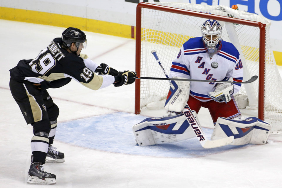 Photo - Pittsburgh Penguins' Beau Bennett (19) can't get his stick on a puck in front of New York Rangers goalie Henrik Lundqvist (30) in the first period of game 2 of a second-round NHL playoff hockey series in Pittsburgh Sunday, May 4, 2014. (AP Photo/Gene J. Puskar)