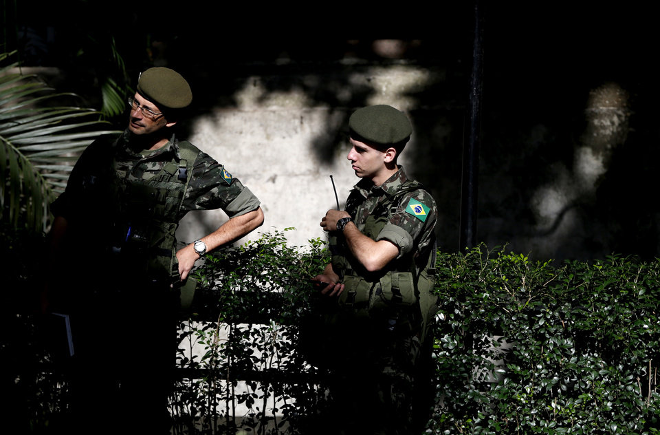 Photo - Security officials stand outside of the United States men's soccer team hotel before the players arrive, in Sao Paulo, Brazil, Monday, June 9, 2014. The U.S. will play in group G of Brazil's 2014 soccer World Cup. (AP Photo/Julio Cortez)