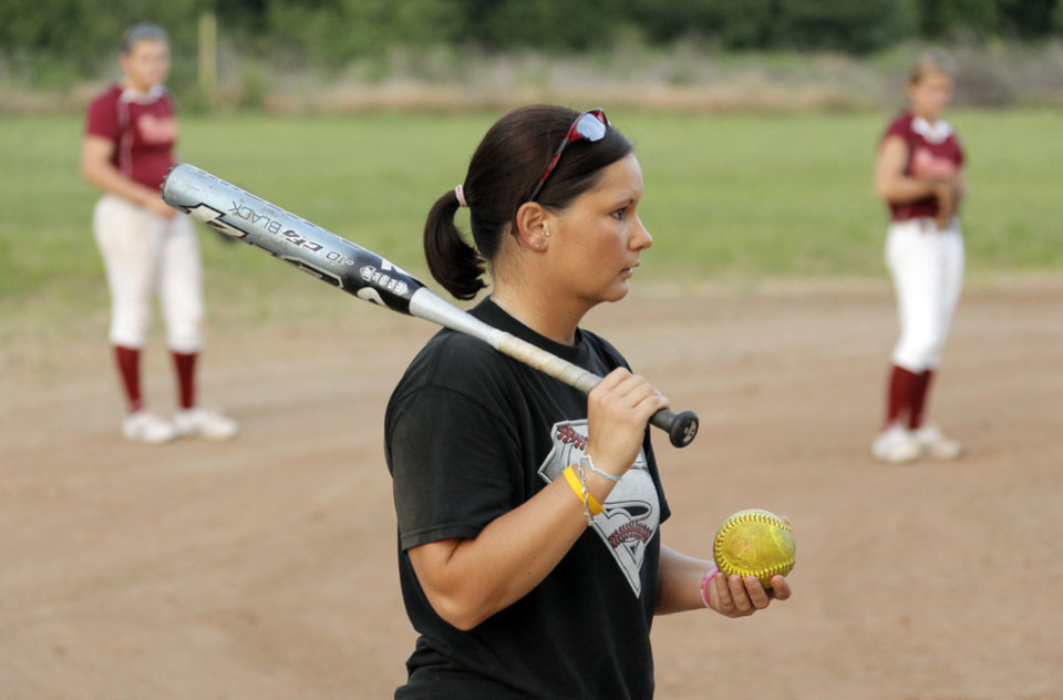 Photo - Coach Mandy Fulton works with her team at practice for the OKC Strikkers softball team in Oklahoma City, Thursday, May 27, 2010.  Mandy Fulton was a member of OU's national championship softball team in 2000. Photo by Nate Billings, The Oklahoman