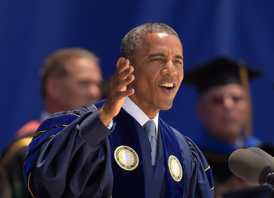 Photo - President Barack Obama delivers the commencement address for the University of California, Irvine, Saturday, June 14, 2014, in Anaheim, Calif. Obama told the graduating class that today's young dreams are fed a steady diet of cynicism but argued they have a right to be optimistic.  (AP Photo/Mark J. Terrill)