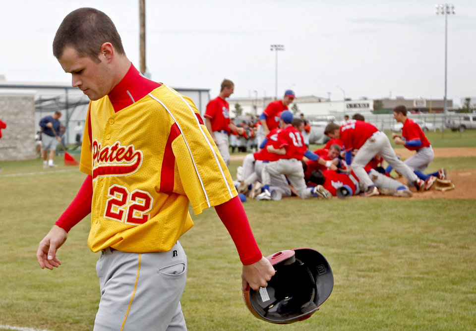 Dale\'s Namath Farriel walks off the field after their loss in the Class 2A high school baseball championship game between Dale and Silo in Shawnee, Okla., Saturday, May 16, 2009. Photo by Bryan Terry, The Oklahoman