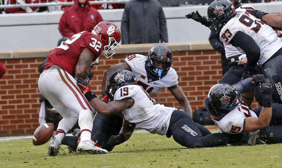 Photo - Oklahoma's Samaje Perine (32) looses the ball near the goal line during the second half of the Bedlam college football game between the Oklahoma Sooners (OU) and the Oklahoma State Cowboys (OSU) at Gaylord Family - Oklahoma Memorial Stadium in Norman, Okla., Saturday, Dec. 3, 2016. Photo by Steve Sisney, The Oklahoman