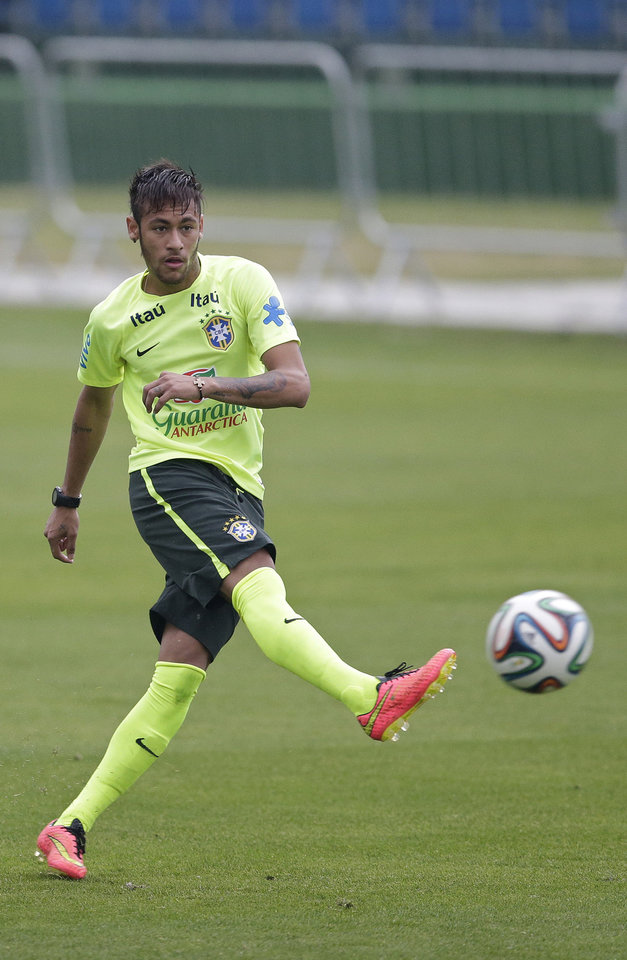 Photo - Brazil's Neymar practices during a training session of the Brazilian national soccer team, at the Granja Comary training center in Teresopolis, Brazil, Monday, June 9, 2014. Brazil plays in group A of the 2014 soccer World Cup. (AP Photo/Andre Penner)