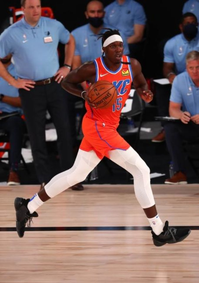 Photo -  August 7, 2020; Lake Buena Vista, Florida, USA; Oklahoma City Thunder forward Kevin Hervey (15) moves the ball up court against the Memphis Grizzlies during the first half of an NBA game at Visa Athletic Center. Mandatory Credit: Kim Klement-USA TODAY Sports