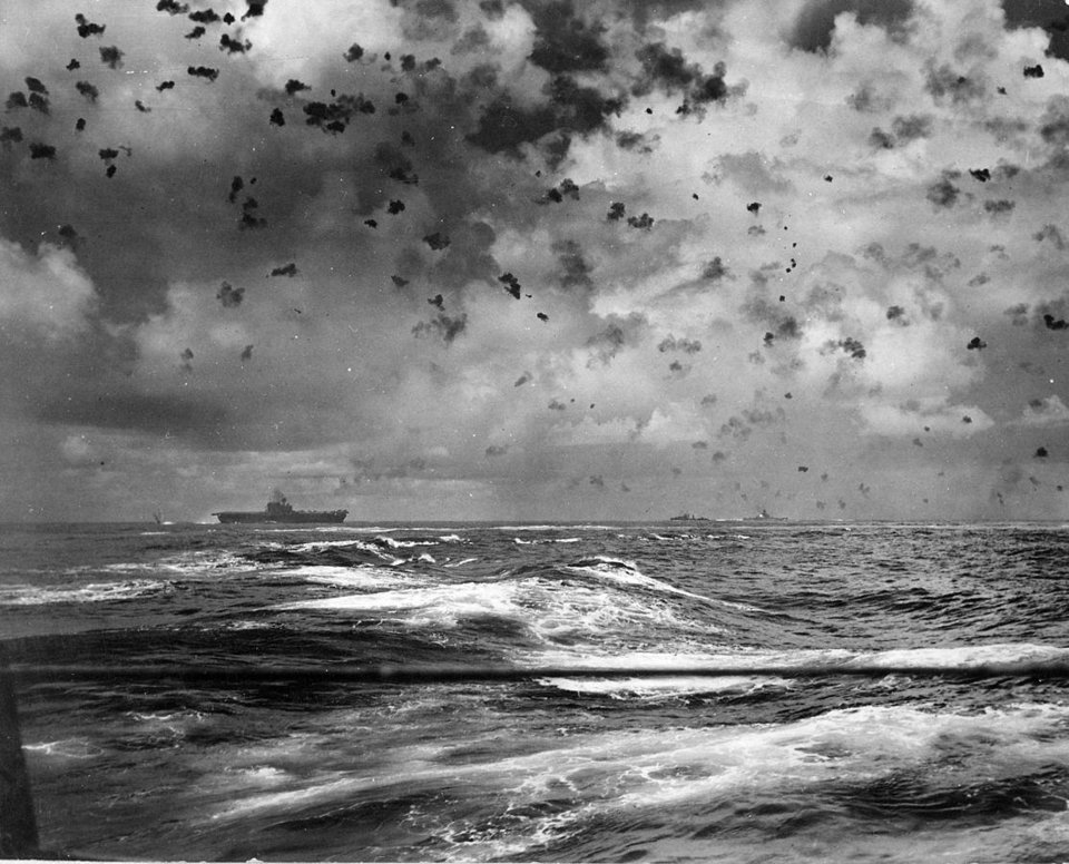 Photo -  The aircraft carrier USS Enterprise under attack in the Pacific during World War II. While on board, Roy Wright, 91, of northwest Oklahoma City, survived multiple kamikaze attacks. [National Archives photo]