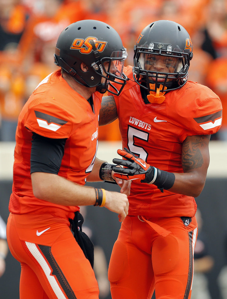 Photo - Oklahoma State's J.W. Walsh (4) and Josh Stewart (5) celebrate after a Stewart touchdown reception from Walsh during a college football game between Oklahoma State University (OSU) and the University of Louisiana-Lafayette (ULL) at Boone Pickens Stadium in Stillwater, Okla., Saturday, Sept. 15, 2012. Photo by Sarah Phipps, The Oklahoman