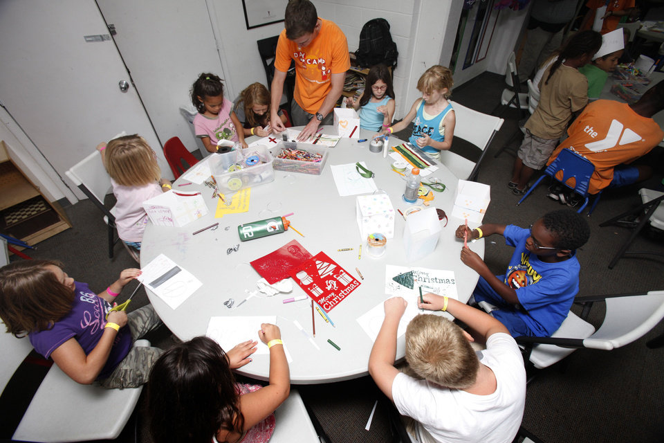 Photo - Children color and construct peace lanterns at the Edmond YMCA in Edmond, OK, Monday, July 16, 2012. The students are creating these for counterparts in Japan to coincide with anniversary of Hiroshima bombing.  By Paul Hellstern, The Oklahoman