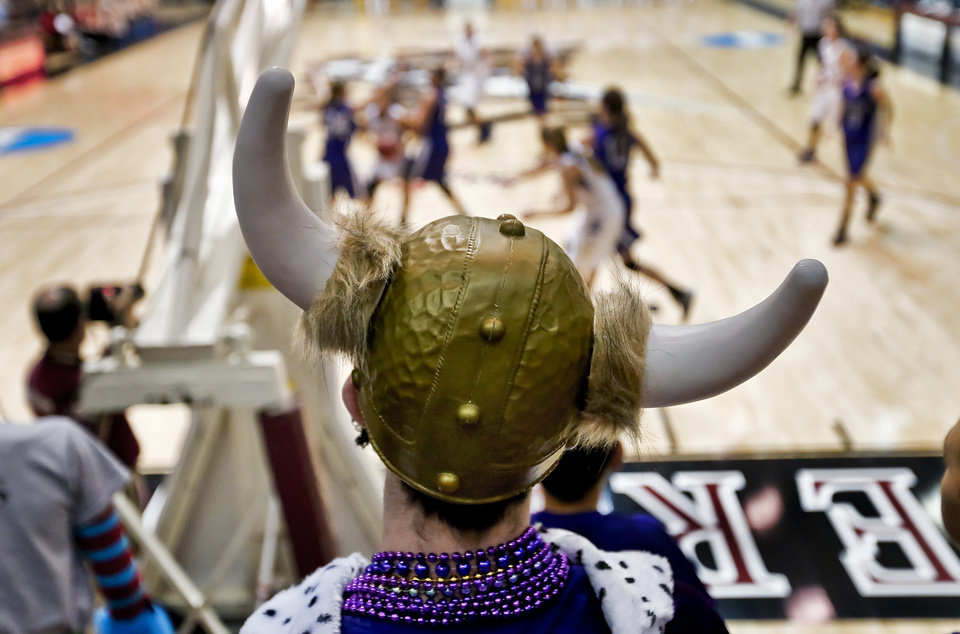 Photo - Burlington fan Marshall Burnet dressed up for the game to watch the Lady Elks during the Class B girls state basketball quarterfinal game between Okarche and Burlington at Southern Nazarene University in Bethany, Okla. on Thursday, March 6, 2014.  Photo by Chris Landsberger, The Oklahoman