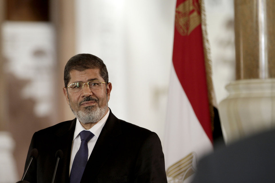Photo -   In this Friday, July 13, 2012 photo, Egyptian President Mohammed Morsi speaks to reporters during a joint news conference with Tunisian President Moncef Marzouki, unseen, at the Presidential palace in Cairo, Egypt. Egypt's president issued constitutional amendments Thursday, Nov. 22, 2012, granting himself far-reaching powers. (AP Photo/Maya Alleruzzo)