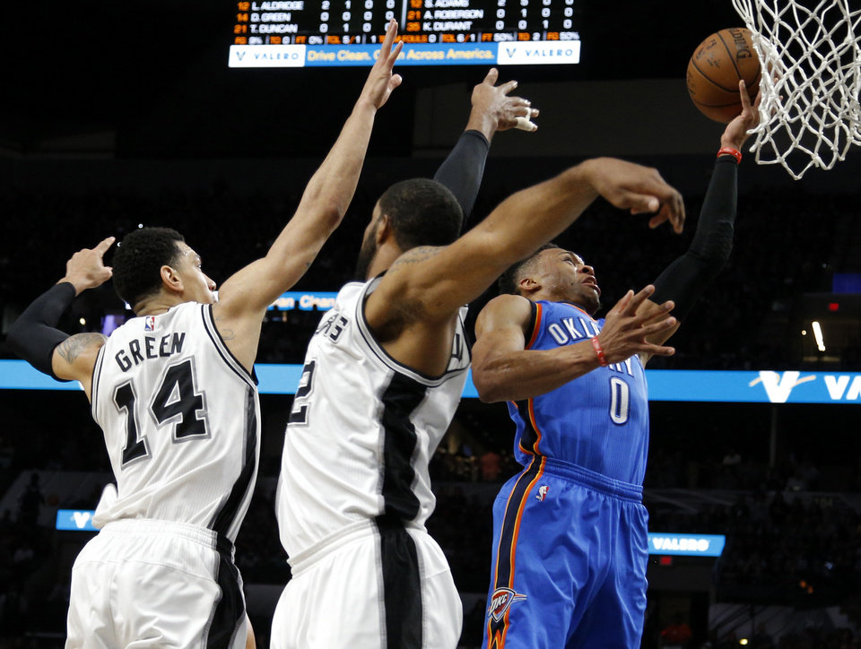 Photo - /tokcon/ goes past San Antonio's Danny Green (14) and LaMarcus Aldridge (12) during Game 2 of the second-round series between the Oklahoma City Thunder and the San Antonio Spurs in the NBA playoffs at the AT&T Center in San Antonio, Monday, May 2, 2016. Oklahoma City won 98-97. Photo by Bryan Terry, The Oklahoman