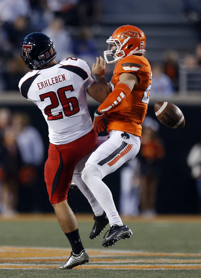Photo - Oklahoma State's Zack Craig (23) blocks the punt of  Texas Tech's Ryan Erxleben (26) during a college football game between Oklahoma State University and the Texas Tech University (TTU) at Boone Pickens Stadium in Stillwater, Okla., Saturday, Nov. 17, 2012. Photo by Sarah Phipps, The Oklahoman
